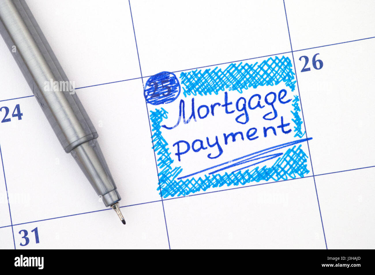 Reminder Mortgage Payment in calendar with blue pen. - Stock Image
