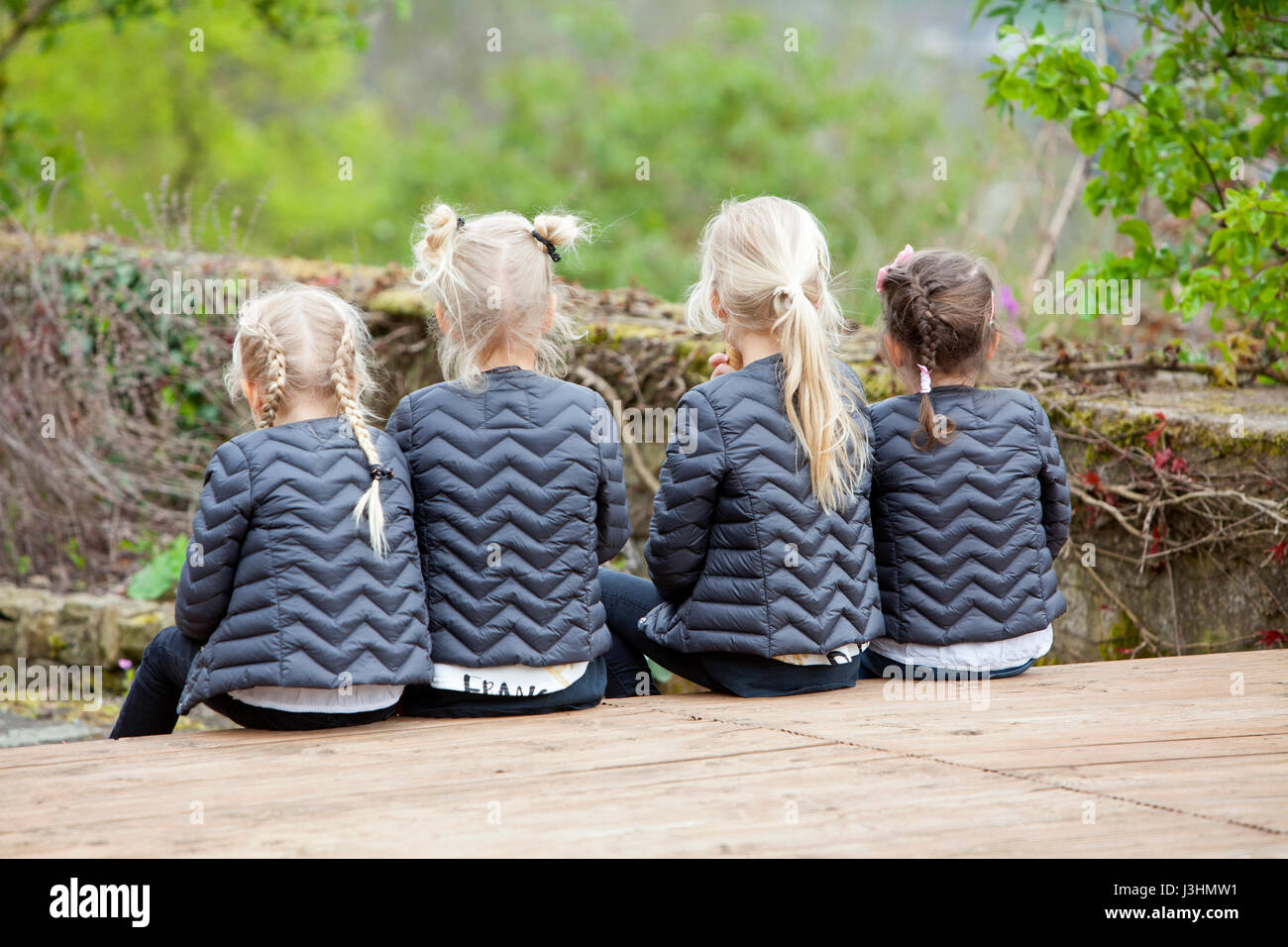 Four girls with equal clothing and hair-style, Germany, Europa - Stock Image