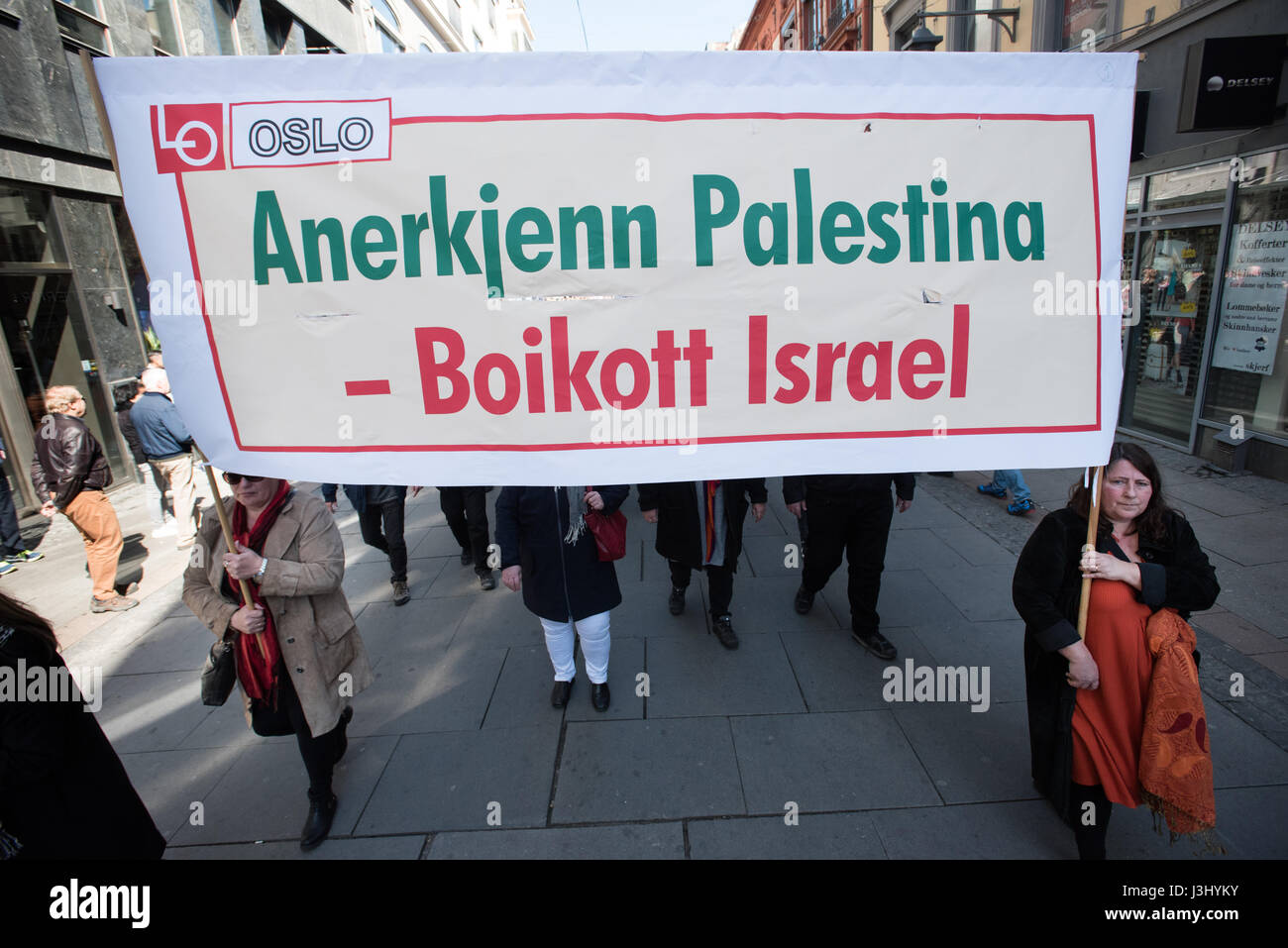 Activists carry a banner in Norwegian: 'Recognize Palestine - Boycott Israel' at the annual May Day march - Stock Image