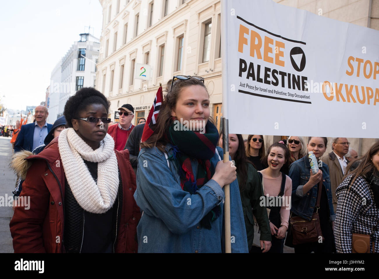Activists carry a banner reading: 'Free Palestine' at the annual May Day march in Oslo, Norway, May 1, 2017. - Stock Image