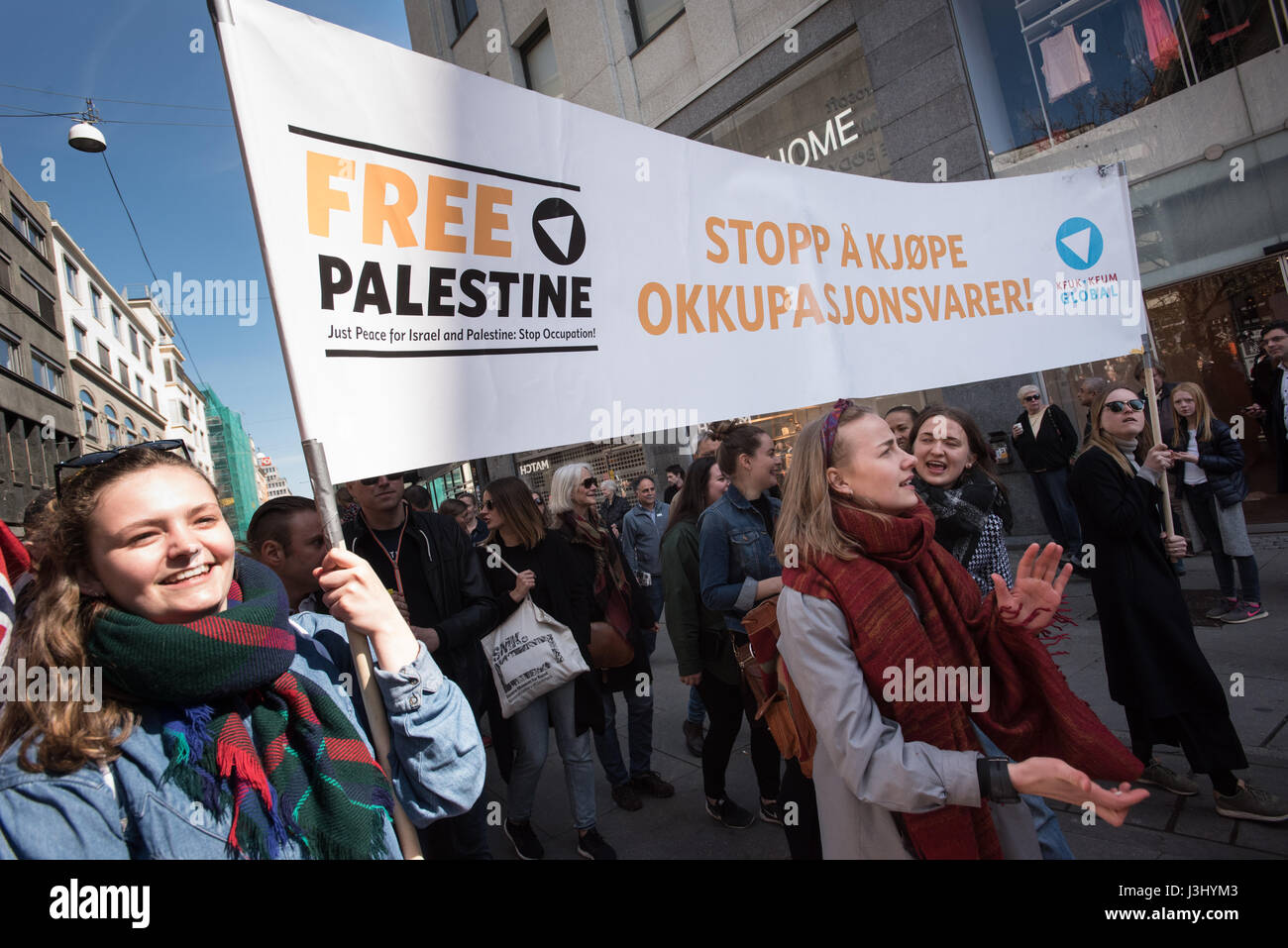 Activists carry a banner in English and Norwegian: 'Free Palestine: Stop Buying Occupation Products' at - Stock Image