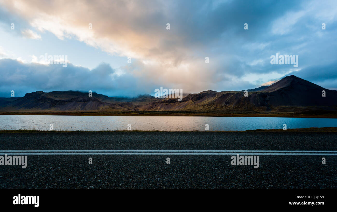 Beautiful landscape in Iceland. Countryside with light and mountain range. - Stock Image