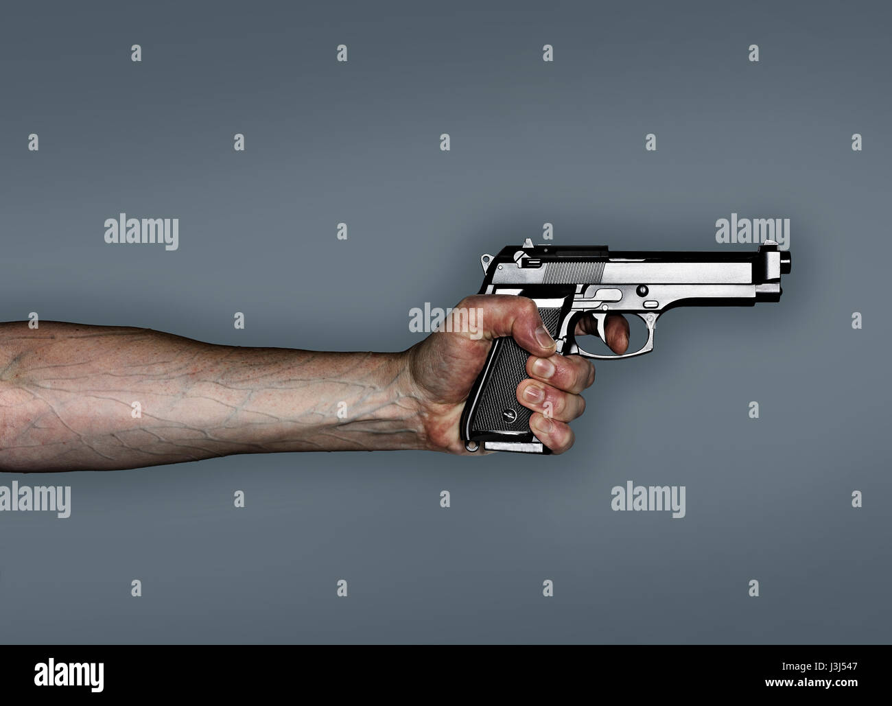 Hand holding revolver, tightly gripping the gun with veins bulging in arm. - Stock Image