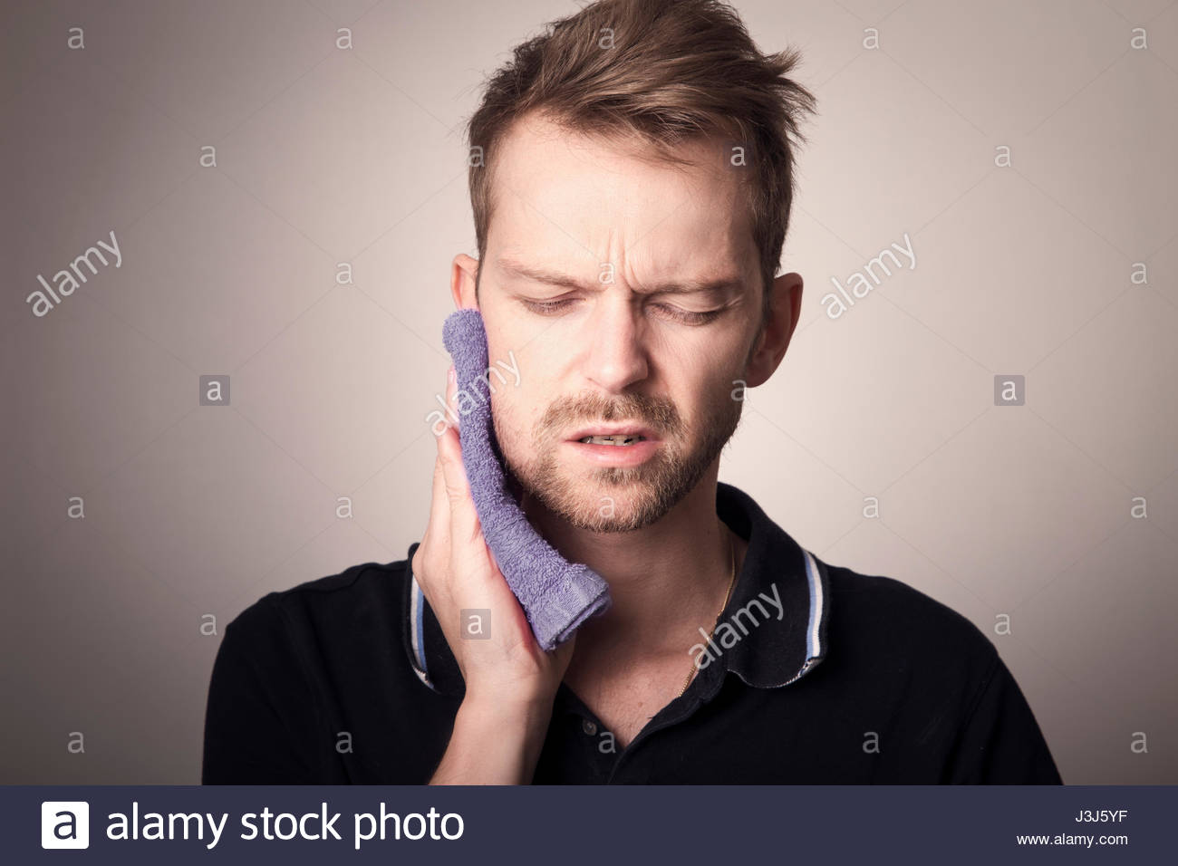 Man having tooth ache after removal of wisdom tooth - Stock Image