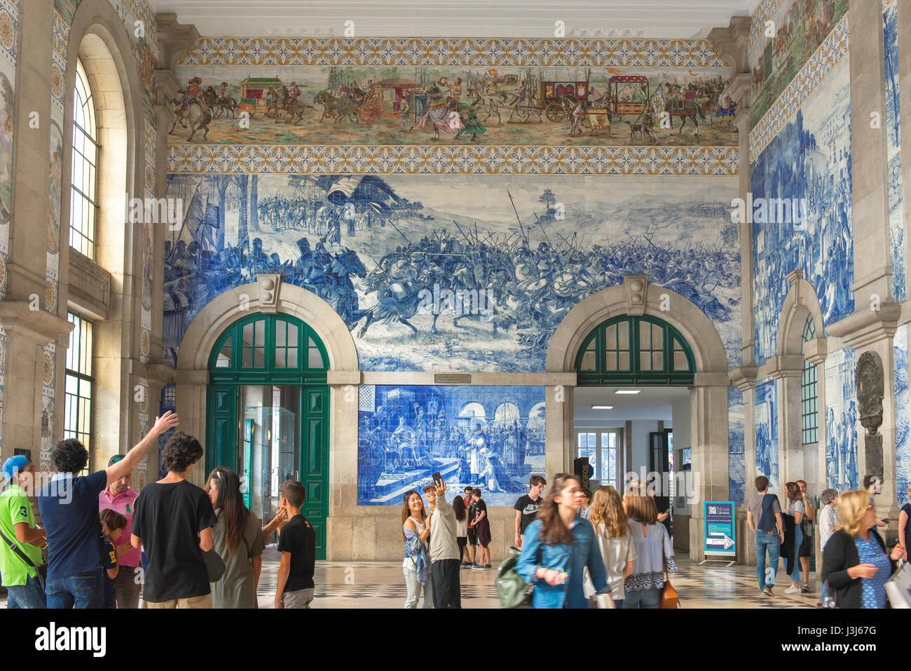 Train station Porto Portugal, the entrance hall of the Sao Bento train station richly decorated with blue azulejo - Stock Image