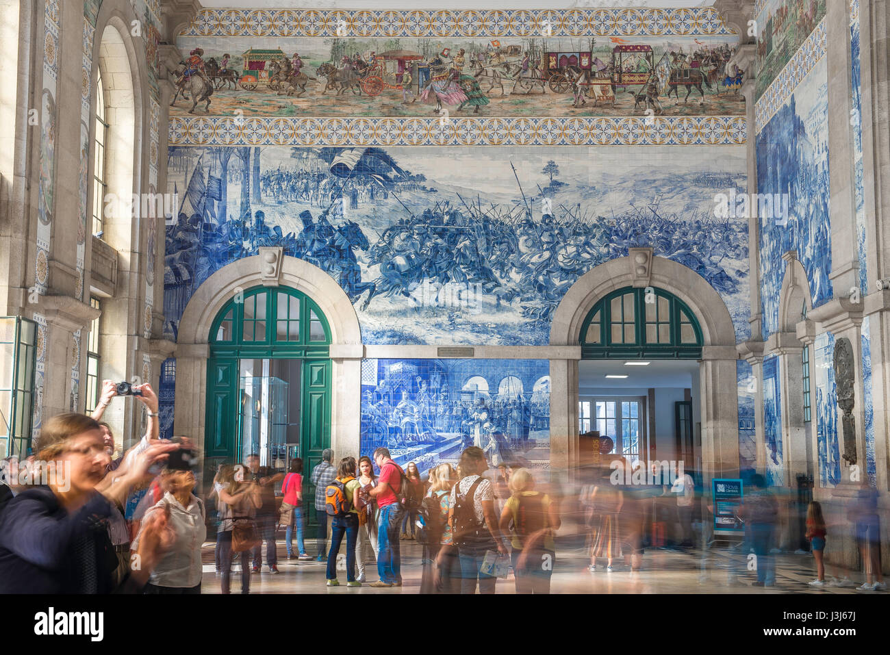Porto Portugal azulejos, the entrance hall of the Sao Bento train station richly decorated with blue azulejo tiles - Stock Image