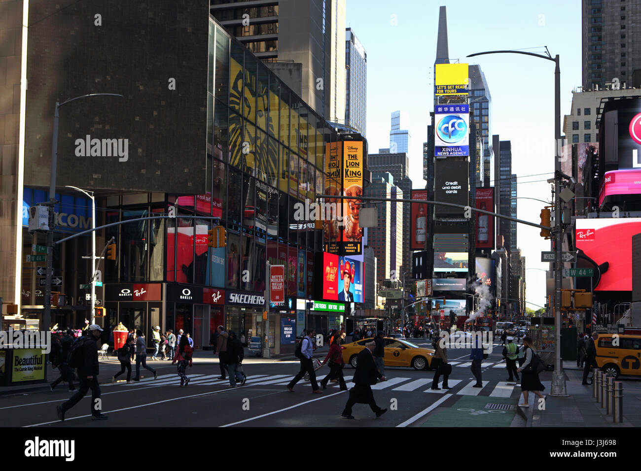 Morning in Times Square New York City along Seventh Avenue at West 44th Street looking north uptown - Stock Image