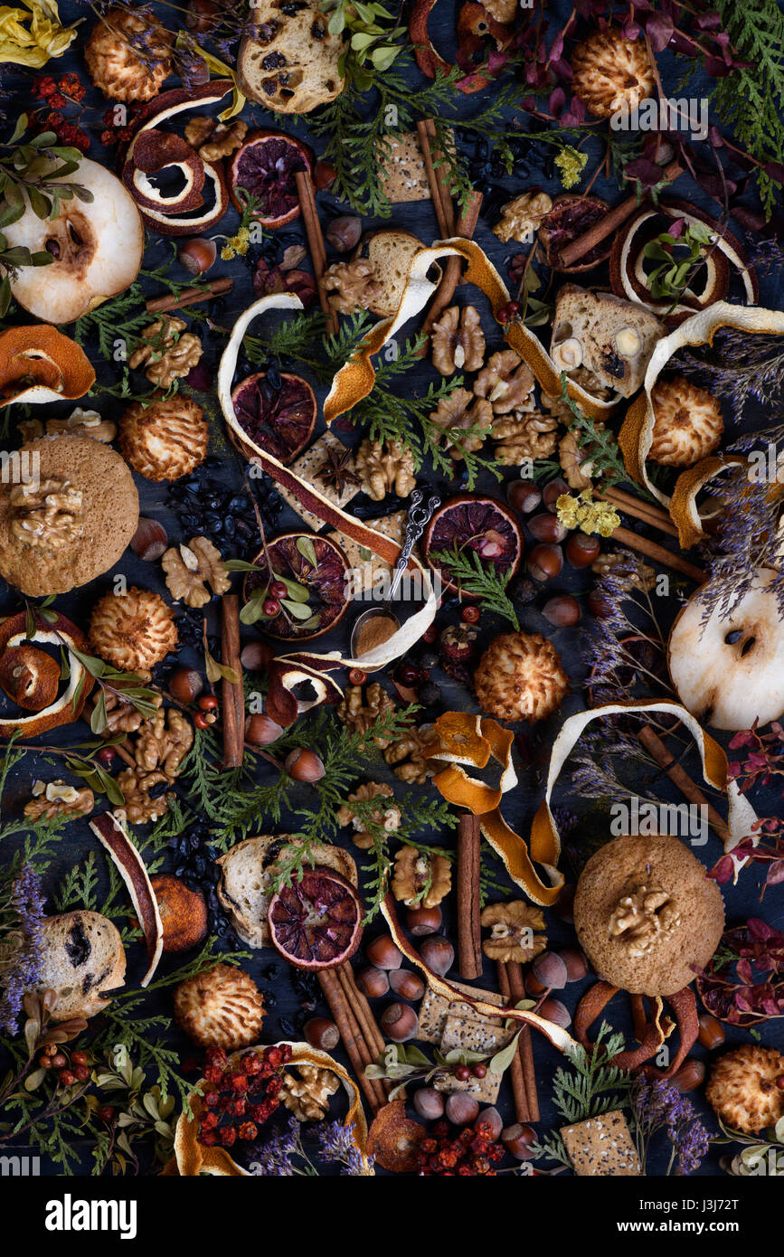 Overhead view of mixed spices,  fruits, nuts and pastry ingredients. Cristmas or thanksgiving theme. Top view. - Stock Image