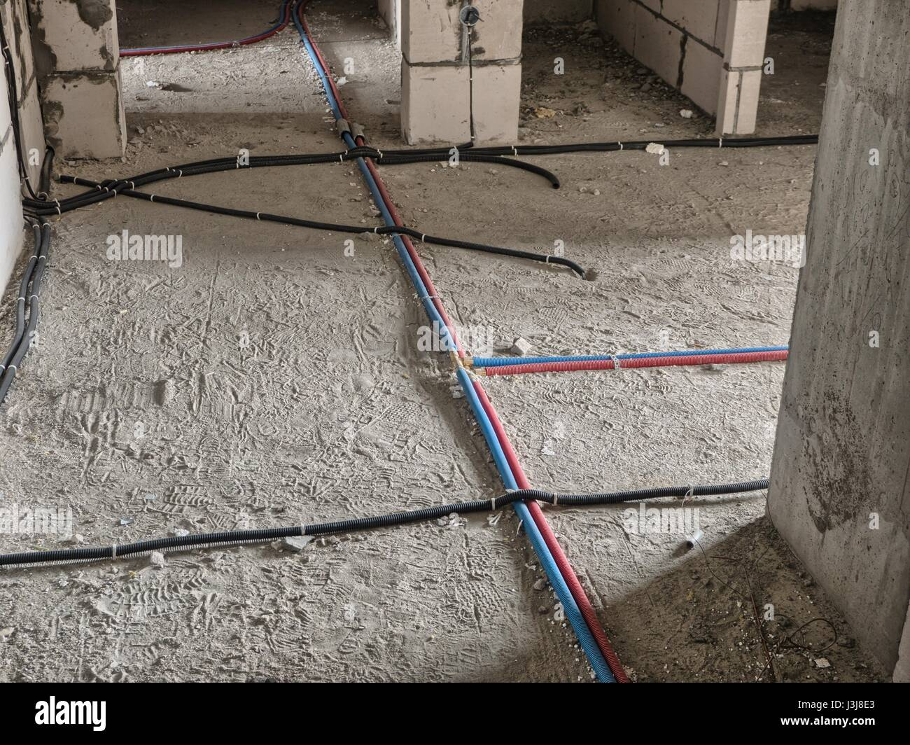Electrical wiring on the floor in the building under construction ...