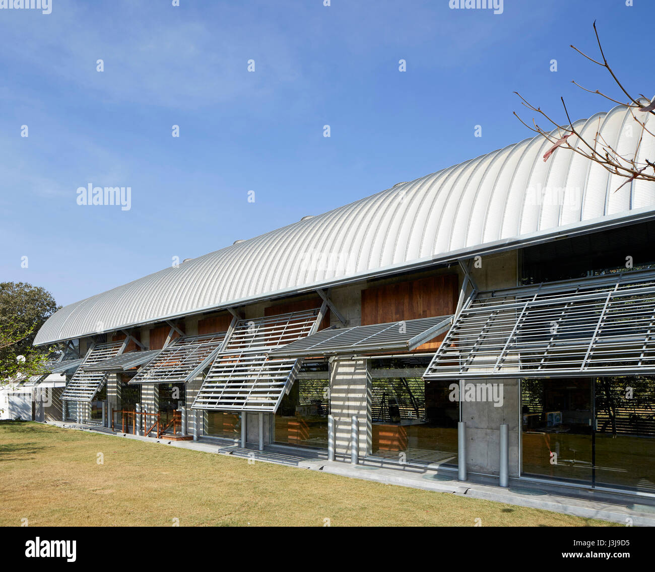 Garden side exterior view. The Pool Studio of Matharoo Associates, Ahmedabad, India. Architect: Matharoo Associates, - Stock Image