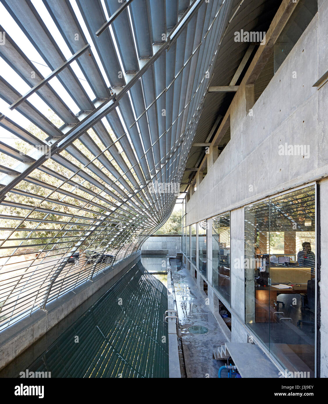 Entrance area under steel canopy with pool. The Pool Studio of Matharoo Associates, Ahmedabad, India. Architect: Stock Photo