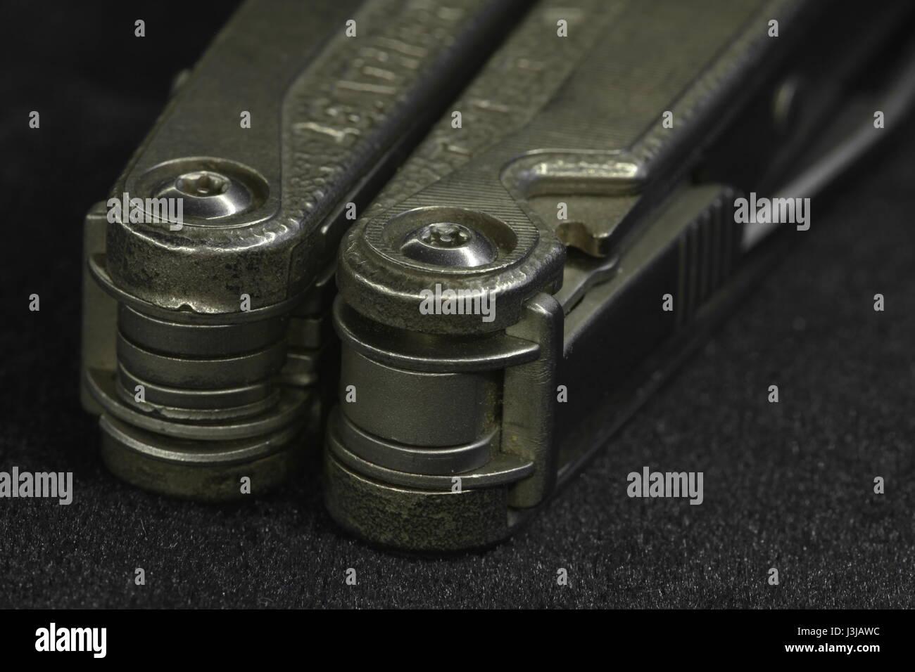 multitool Steel knife macro shot - Stock Image