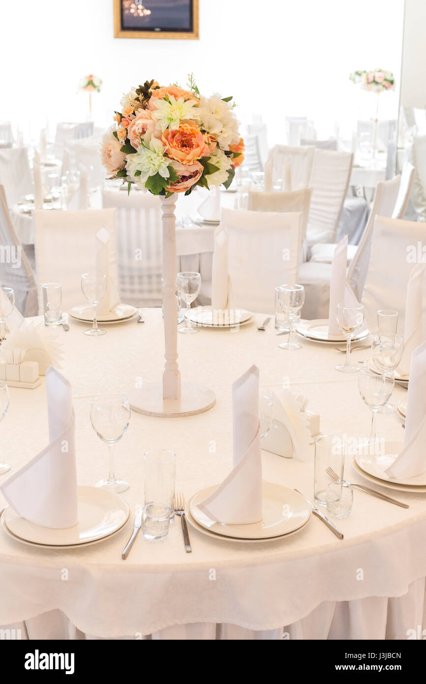 Festive table setting in classic style in a white restaurant interior setout. Wedding table decor concept. Fine art. Expectation of guests. Verical.  sc 1 st  Alamy & Festive table setting in classic style in a white restaurant Stock ...