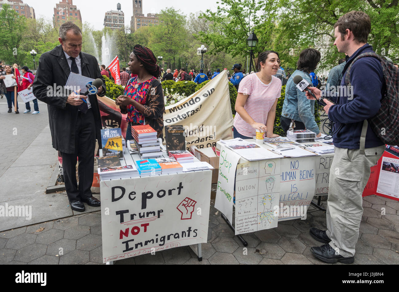 New York, NY USA - 1 May 2017 - Members of the Socialist Alternative tabeling at a May Day rally, speak with the - Stock Image