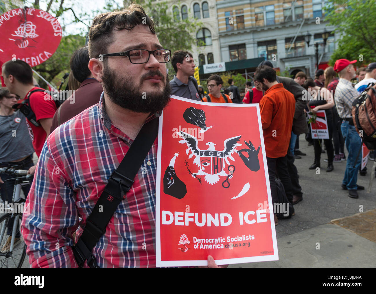 New York, NY 1 May 2017 - Protester with a sign to defund ICE (Immigration and Customs Enforcement) Democratic Socialists - Stock Image