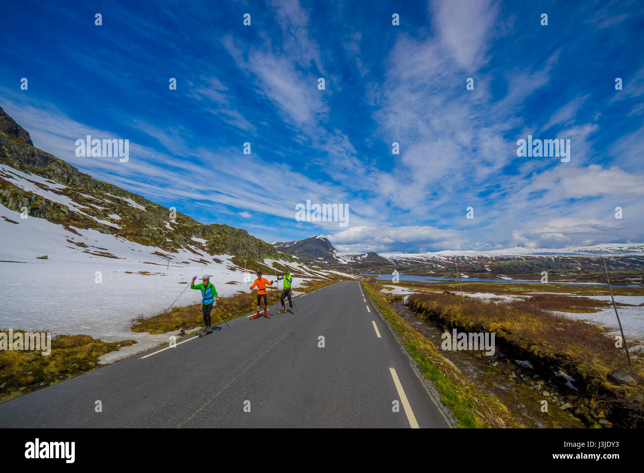VALDRES, NORWAY - 6 JULY, 2015: Beautiful road passing through Valdresflya mountain range sorrounded by stunning - Stock Image