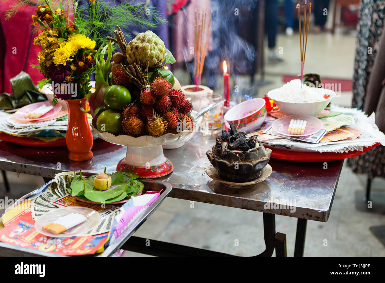 Altar of sacrifice on Full Moon festival. Vietnamese burn incense and put some goods on the table in order to have - Stock Image