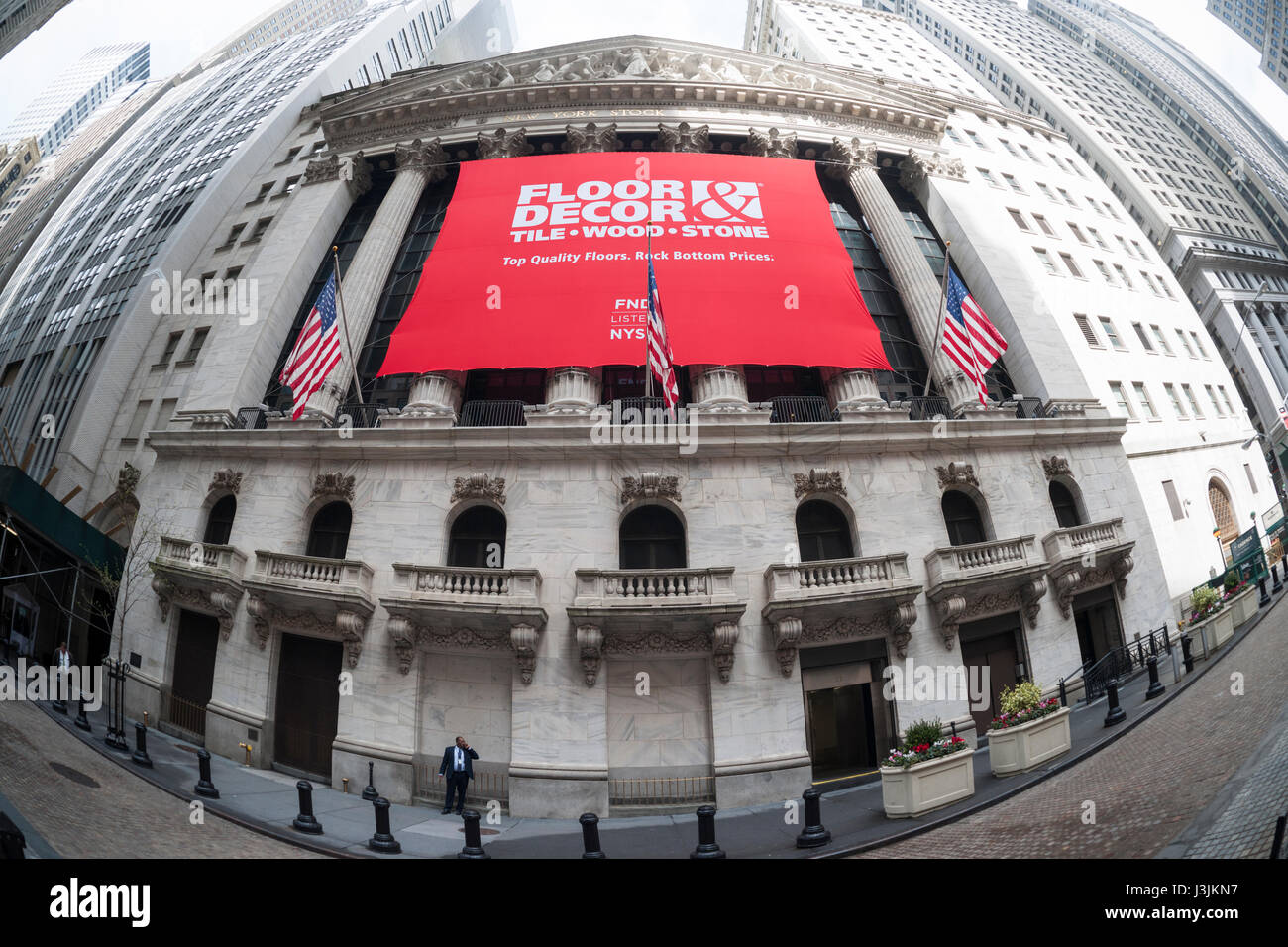The facade of the New York Stock Exchange is decorated for the first day of trading for Floor & Decor Holding's - Stock Image