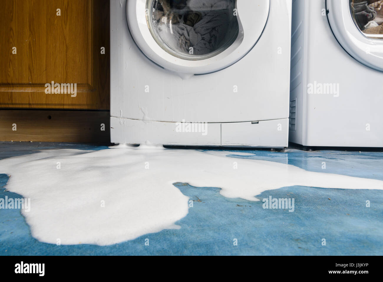 Washing Machine Leaking >> Soap Bubbles Pour Out Of A Leaking Washing Machine Stock Photo