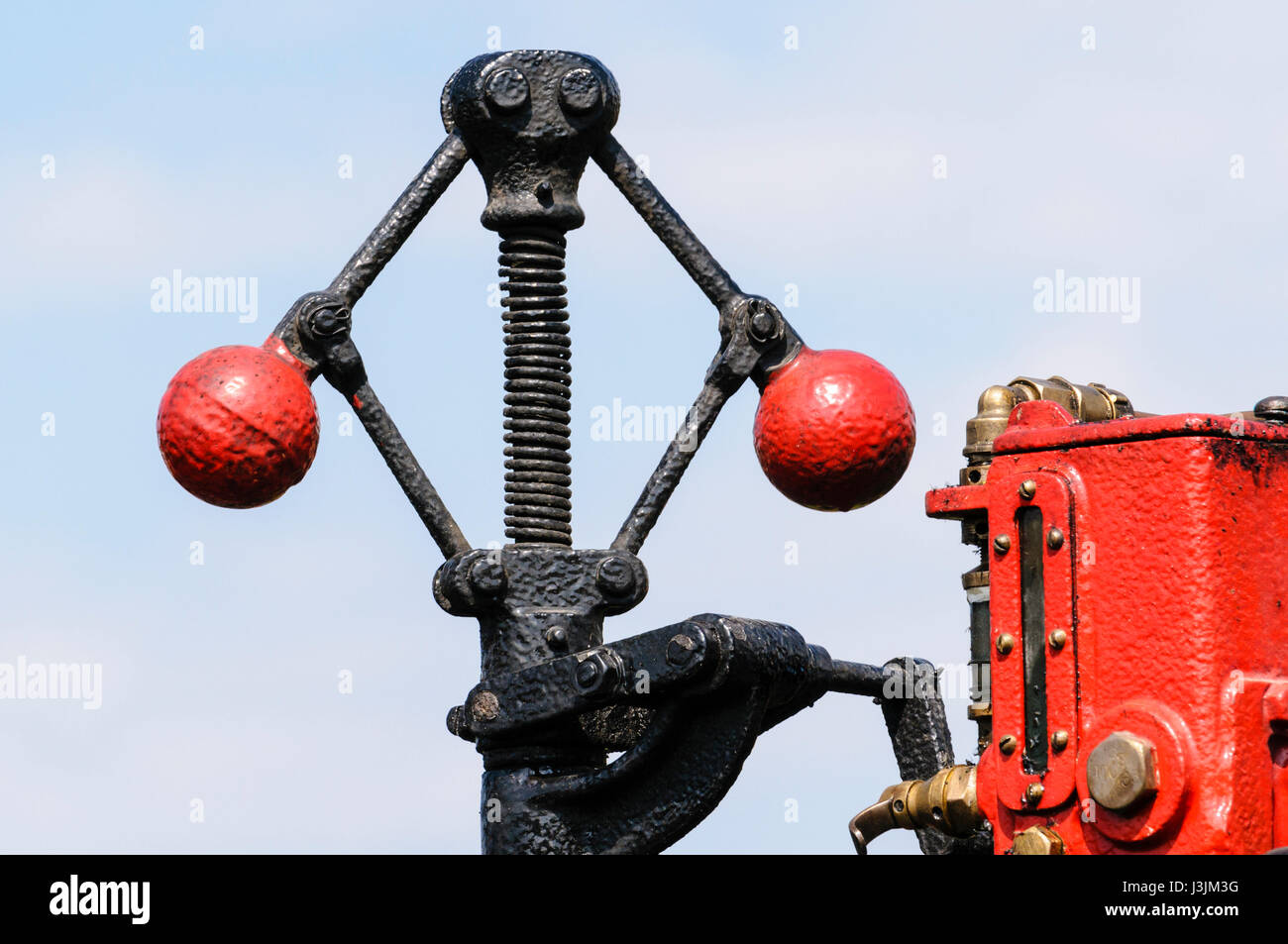 Iron balls on the Centrifugal governor mechanism of a traction engine - used to control the speed of the engine. - Stock Image