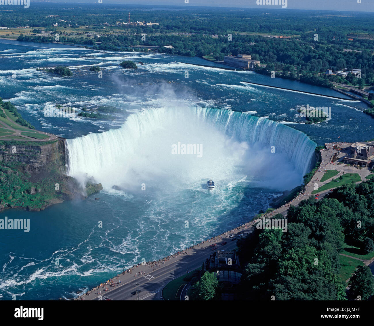 Niagara Falls and Maid of the Mist pleasure boat, Ontario, Canada - Stock Image