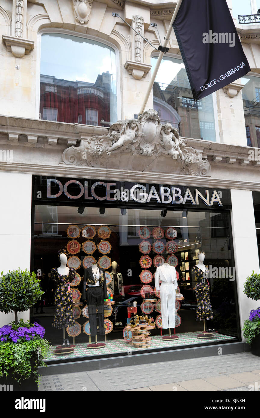 Exterior view of Dolce & Gabbana designer fashion store window display in Old Bond Street London  UK KATHY DEWITT - Stock Image