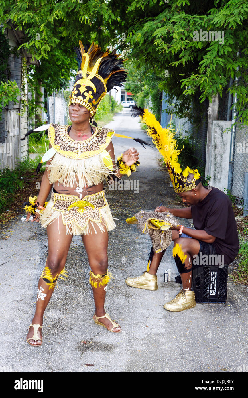 Miami Florida NE Second 2nd Avenue Miami Caribbean Carnival colorful costume festival parade Black woman man alley - Stock Image