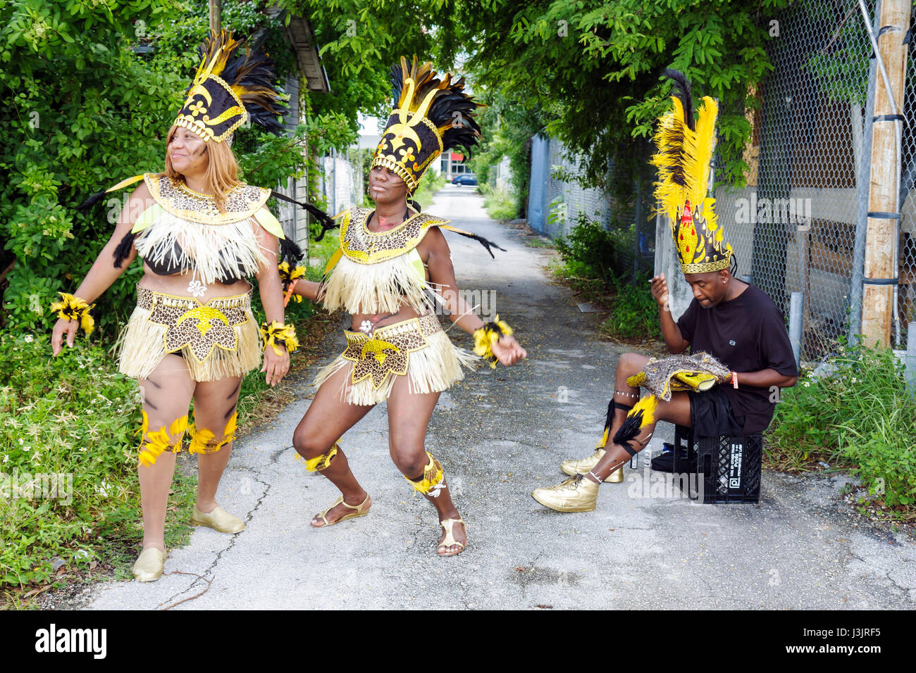 Miami Florida NE Second 2nd Avenue Miami Caribbean Carnival colorful costume festival parade Black woman women man - Stock Image