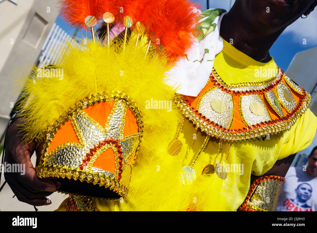 Miami Florida NE Second 2nd Avenue Miami Caribbean Carnival costume festival parade Black man colorful headdress - Stock Image