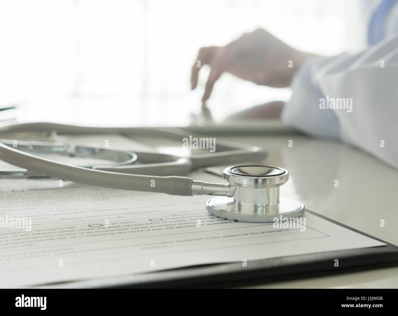 Close-up of stethoscope and medical Documentation on  background doctor working - Stock Image