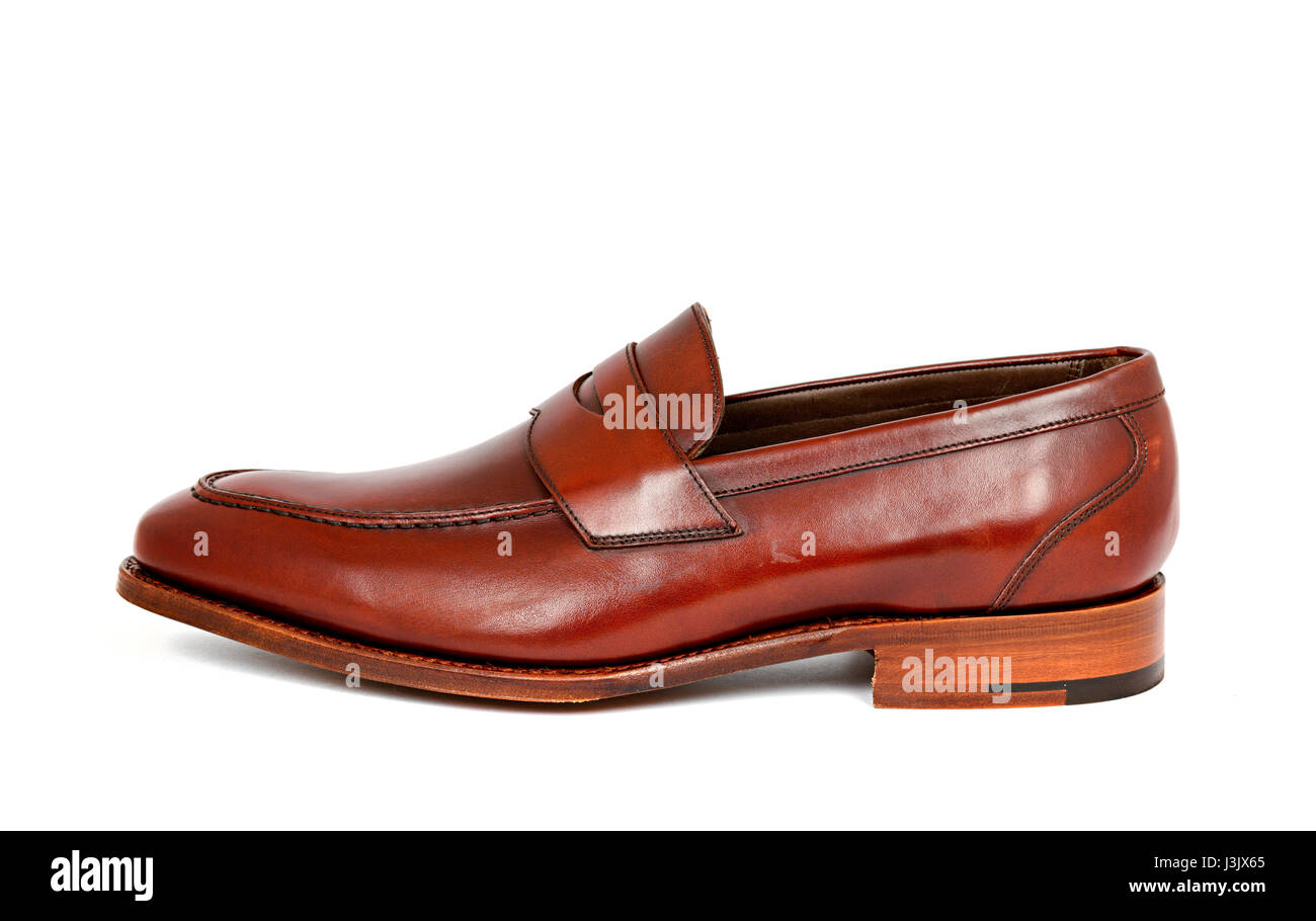 cherry calf penny loafer shoe toe to left on white background. Horizontal image - Stock Image