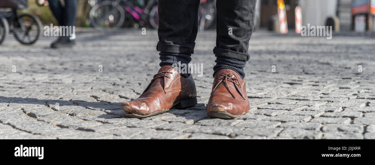 Close up of a pair of worn out shoes with relieved shoe sole - Stock Image
