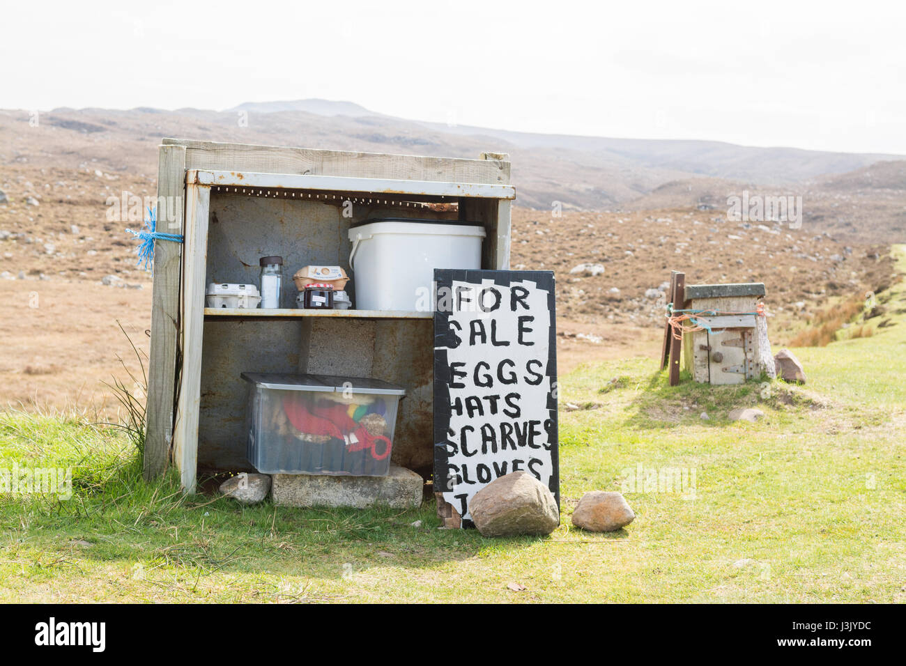 honesty shop on the North Coast 500 route round the Applecross peninsula selling eggs, hats, scarves, gloves, Scotland, - Stock Image