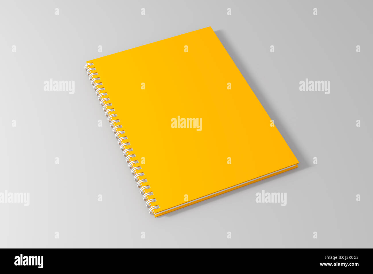 blank empty yellow spiral notebook template on clean white stock