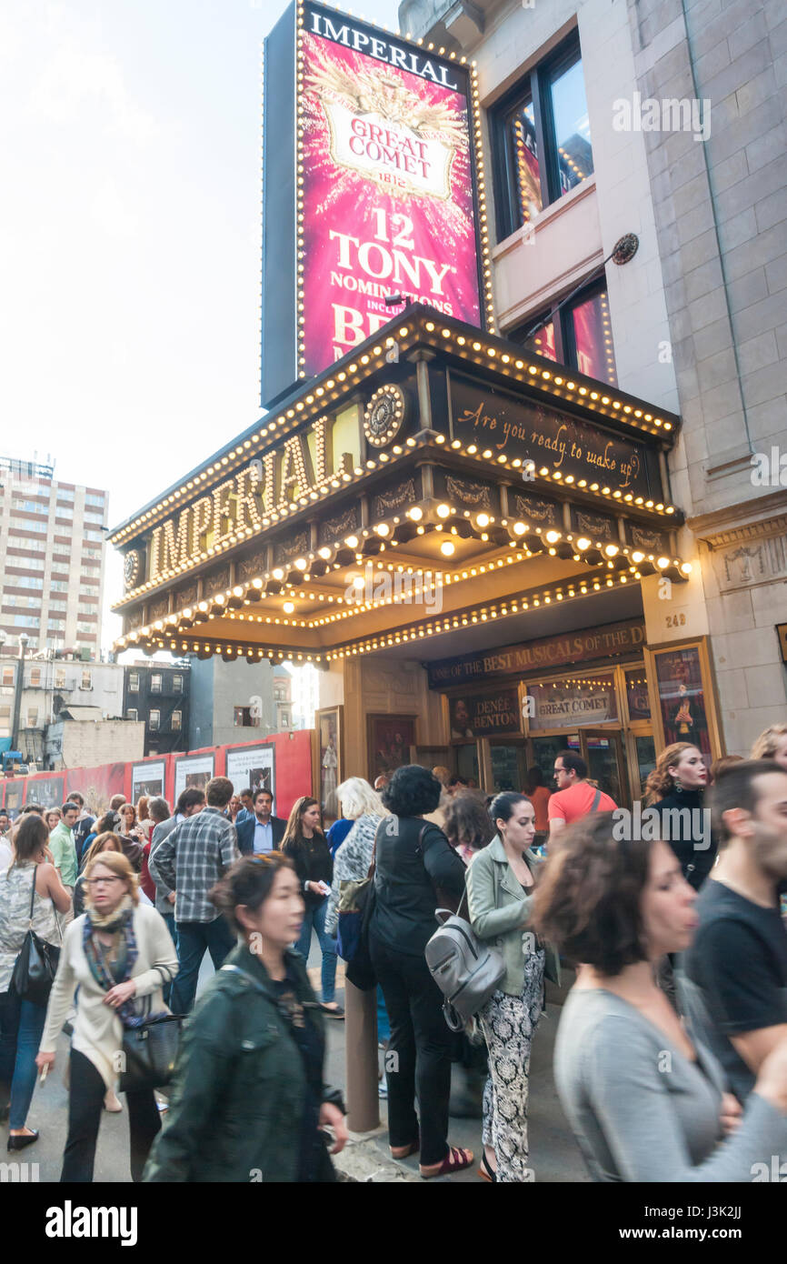 Throngs of theatergoers descend on the Imperial Theatre on Broadway in New York to see a performance on Tuesday, Stock Photo
