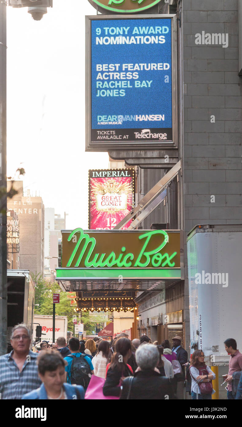Throngs of theatergoers descend on the Music Box Theatre on Broadway in New York to see a performance on Tuesday, Stock Photo