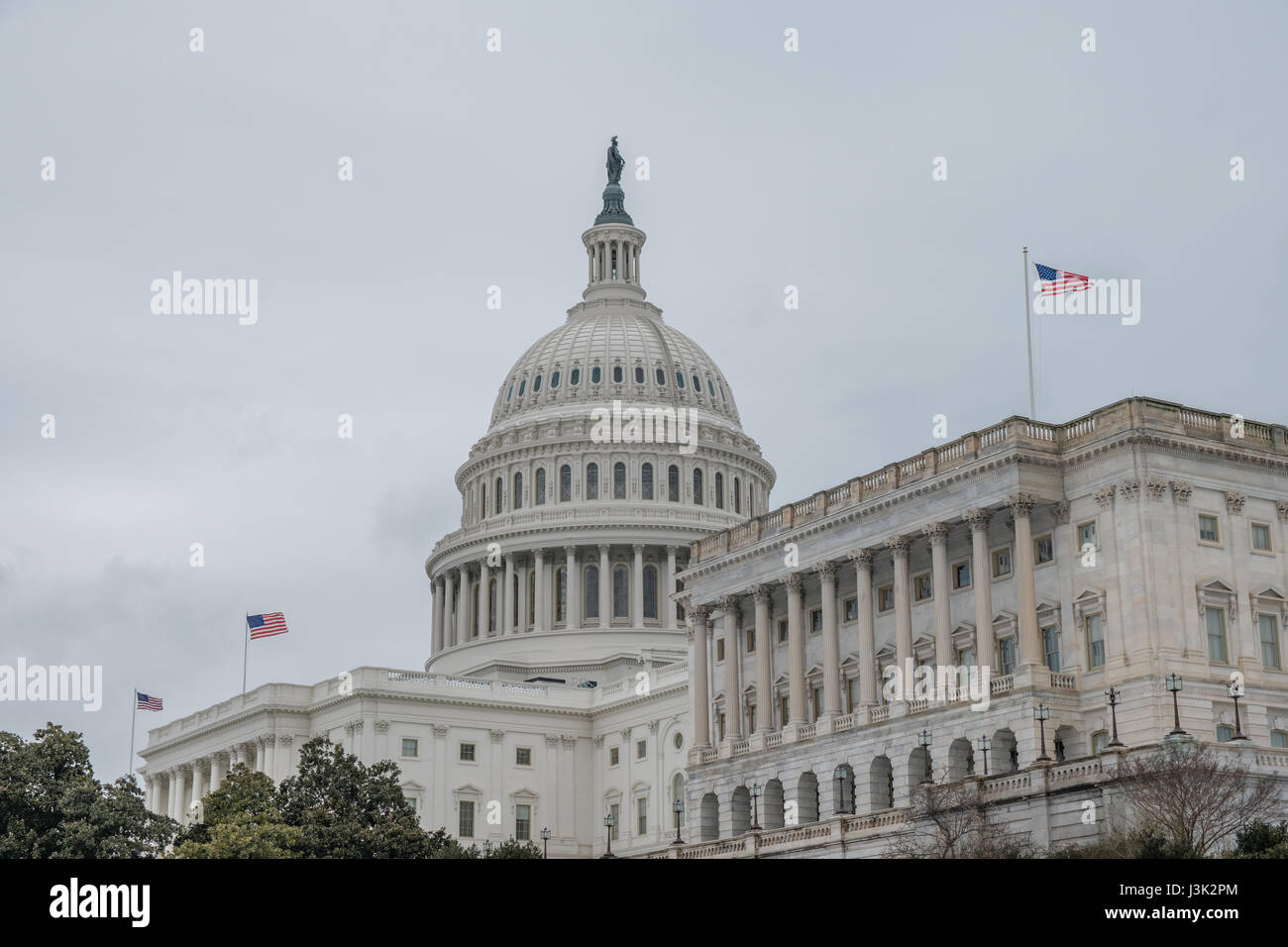 U.S. Capitol Building with Three American Flags - Stock Image
