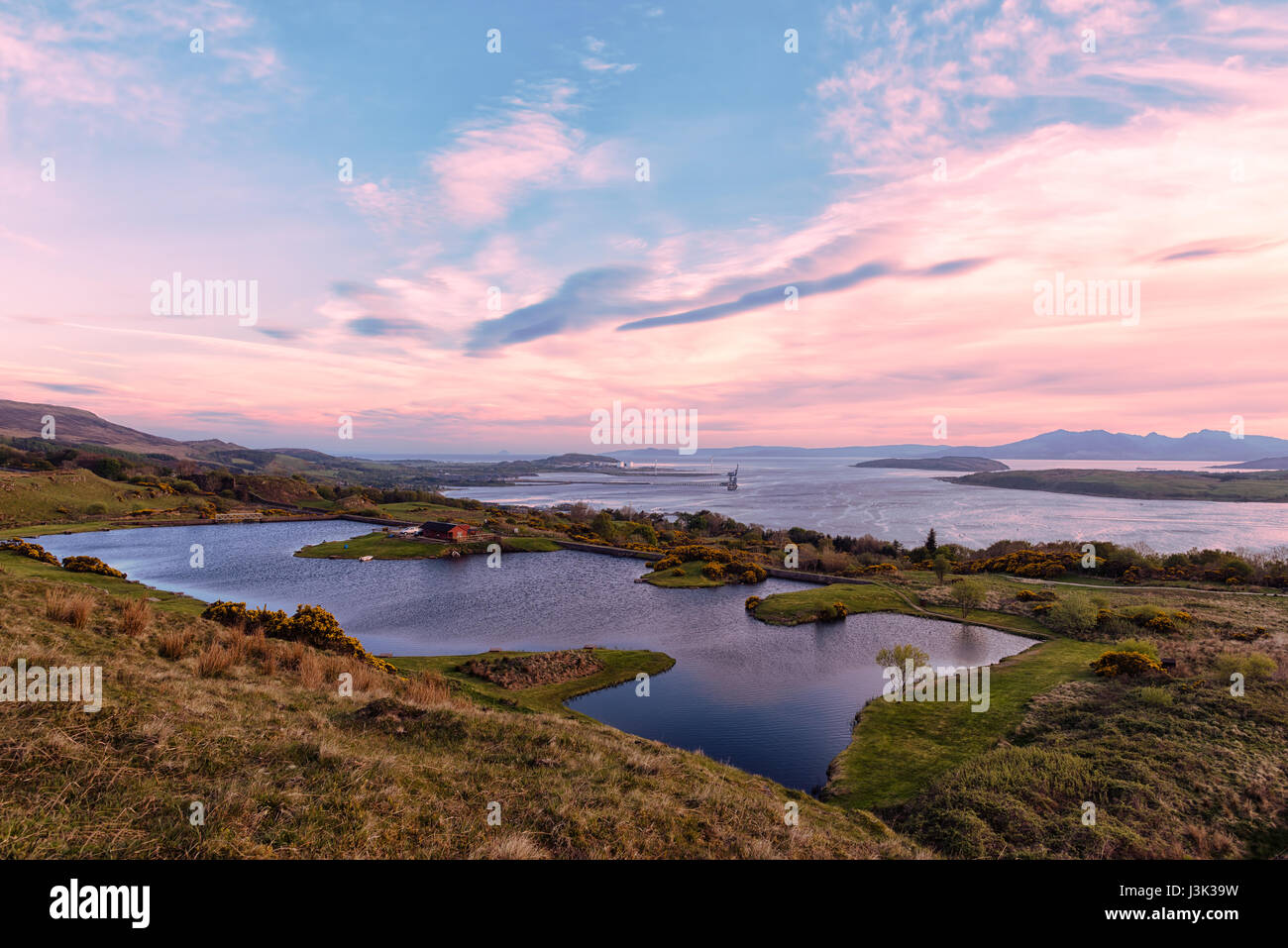Largs Reservoir clyde valley down to Hunterston and Arran in the misty distance. - Stock Image