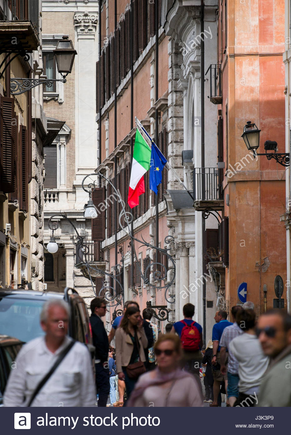 Italian and European Union flags on poles from a balcony, Municipio I, Rome, Lazio, Italy - Stock Image