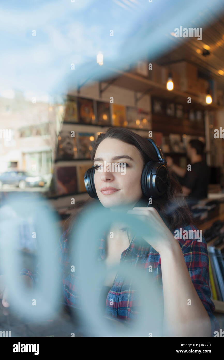Young woman wearing headphones. Stock Photo