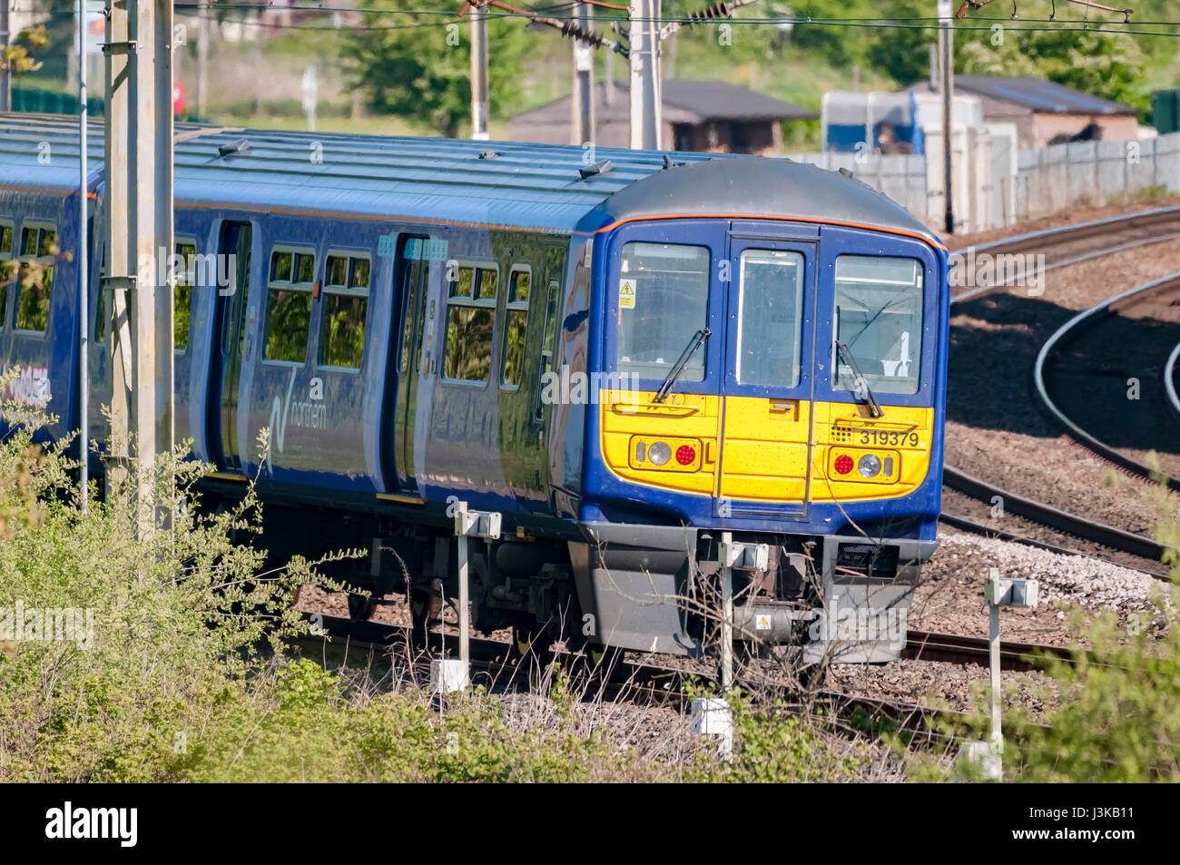 Northern Rail Class 31 electric multiple unit passenger train at Winwick junction. - Stock Image