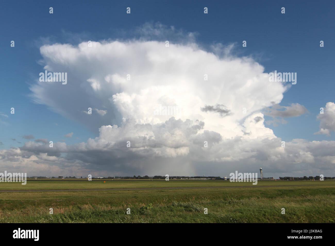 Cumulonimbus capillatus above airport - Stock Image