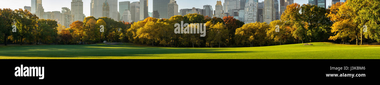 Panoramic view of Central Park South from Sheep Meadow in early morning sunlight. Midtown skyscrapers. Manhattan, - Stock Image