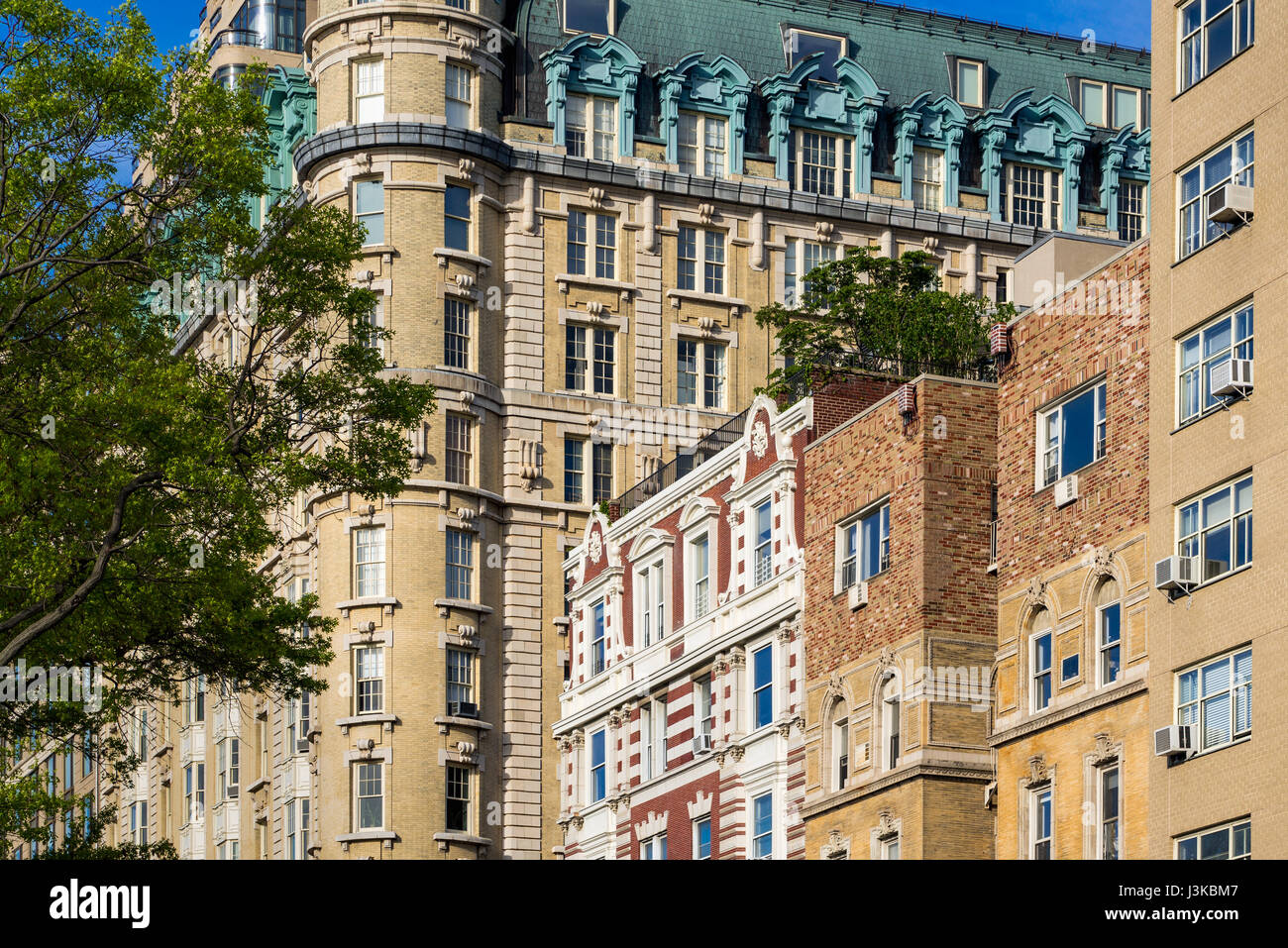Facades of high-rise buildings on Central Park West. Upper West Side on sunny morning. Manhattan, New York City - Stock Image