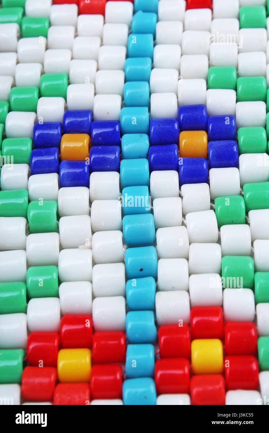 Retro vintage barrel glass beads. Beading flower hobby close up photo. - Stock Image