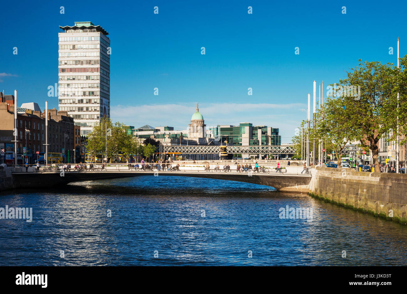 Looking eastwards along the River Liffey from O'Connell Bridge towards Rosie Hackett Bridge with Liberty Hall and - Stock Image