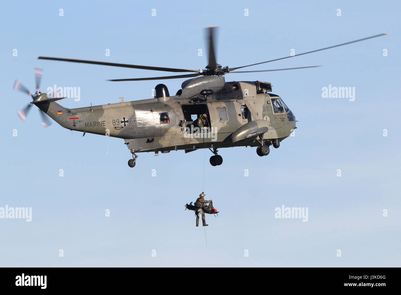 German Navy Westland Sea King Mk.41 helicopter on a search and rescue training winching exercise - Stock Image