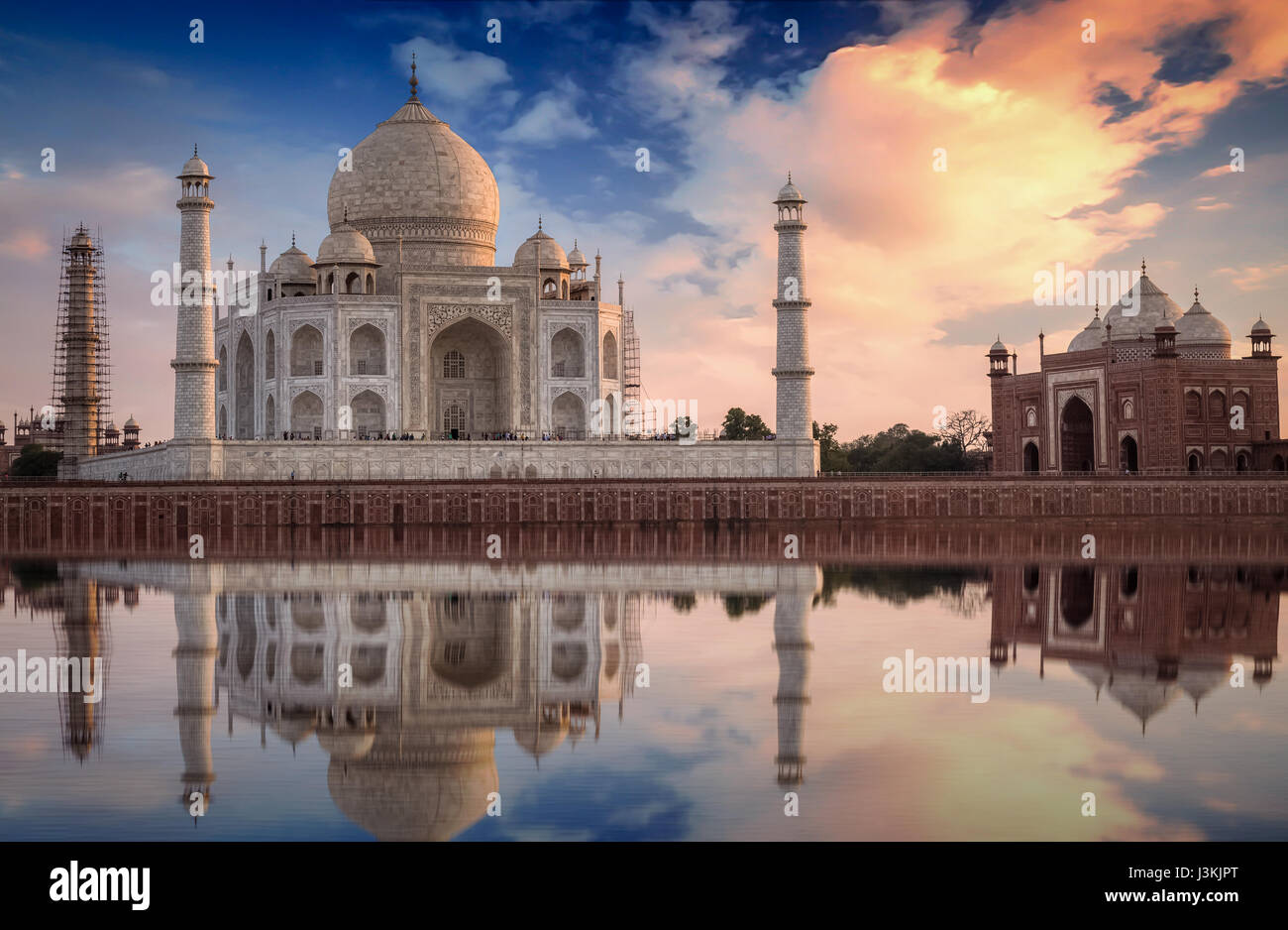 Taj Mahal sunset view from the banks of Yamuna river. Taj Mahal is a white marble mausoleum designated as a UNESCO - Stock Image