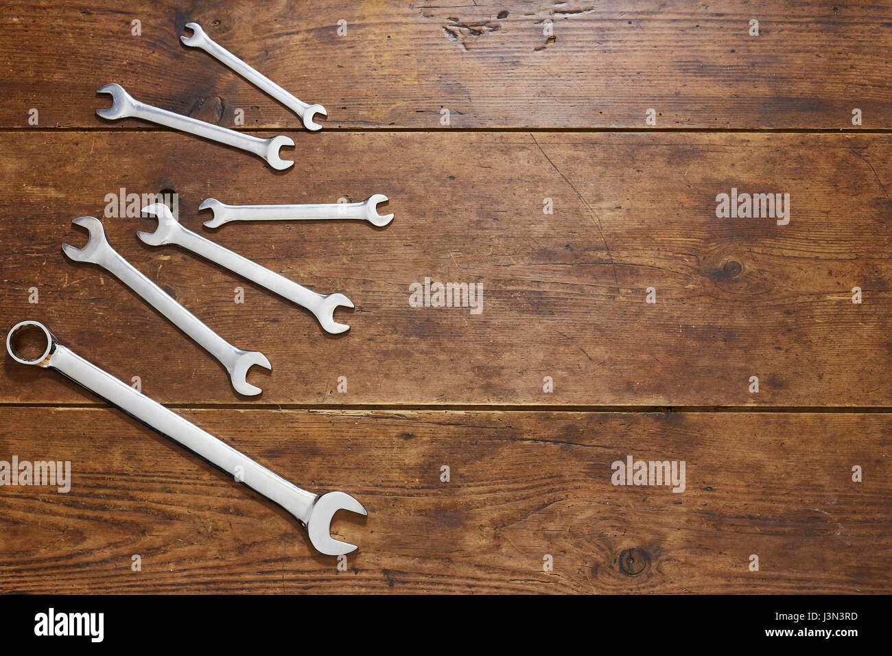 Scattered spanners on table top - Stock Image