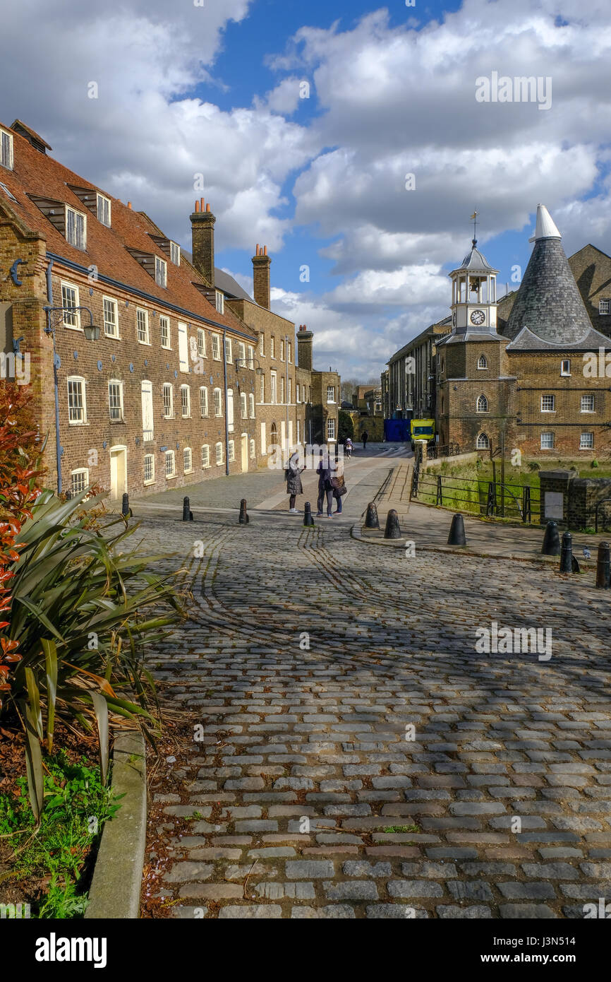 House Mill and Three Mills in East London, portrait view taken in Spring. - Stock Image
